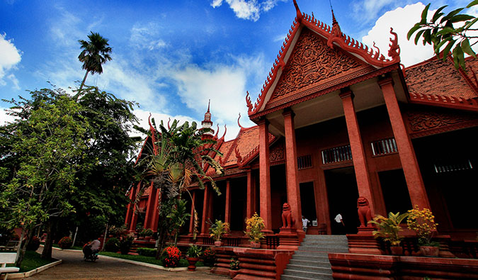 A vibrant red temple building in Phnom Penh, Cambodia