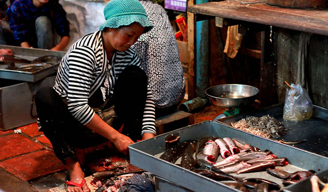 A local woman selling seafood in Phnom Penh, Cambodia