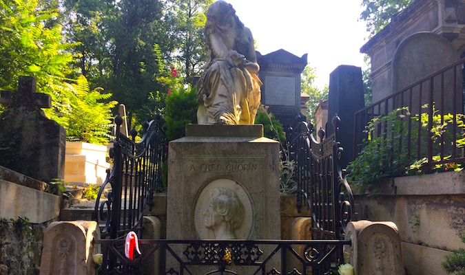 Sad statue of a woman mourning at pere lachaise graveyard