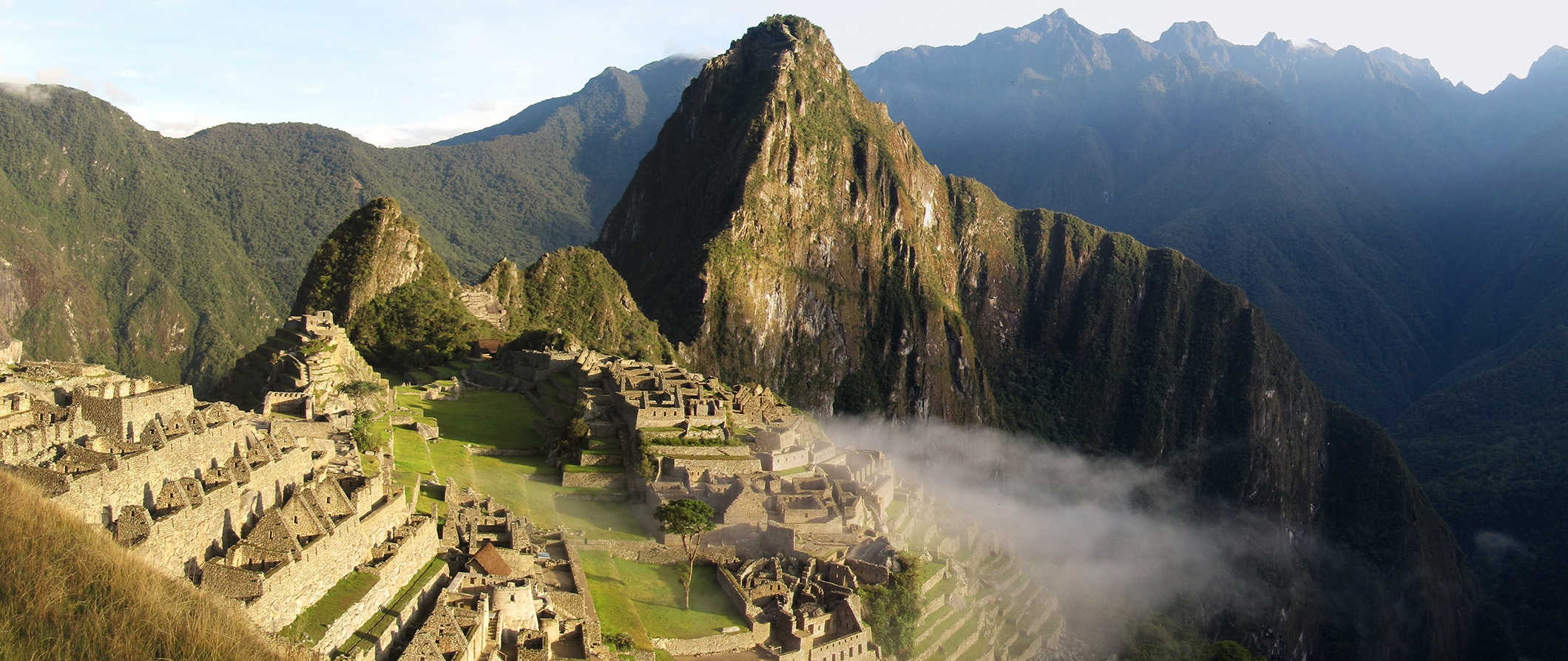 Machu Picchu, Peru with light fog flowing through the ruins