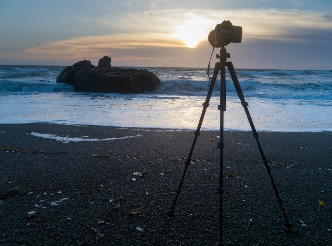 Tripod and camera set up on a natural beach overseas