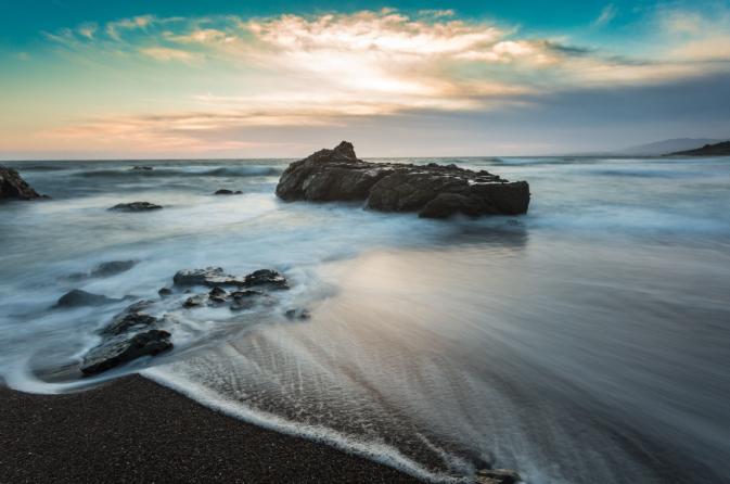 Big rock in an ocean landscape photograph