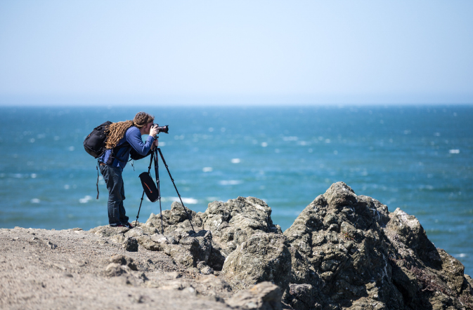 Photographer and gear set up near the ocean