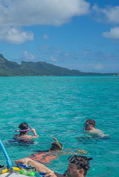 People snorkeling in the clear waters of French Polynesia