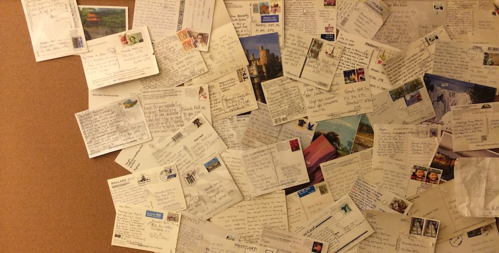send postcards to nomadic matt