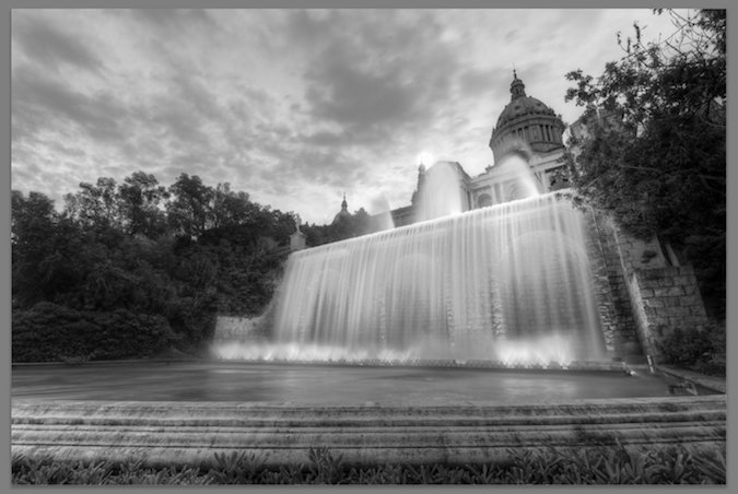 Photo of orange building and waterfall - black and white - desaturated