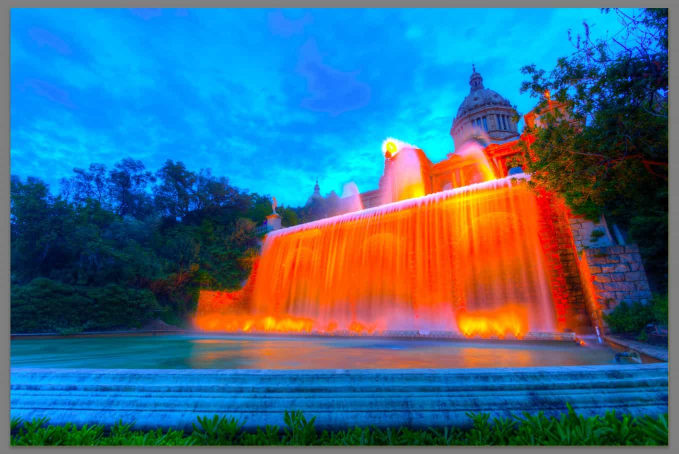 Photo of orange building and waterfall - neon - saturated
