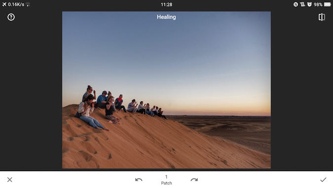 People sitting on a sand dune in Lightroom 4