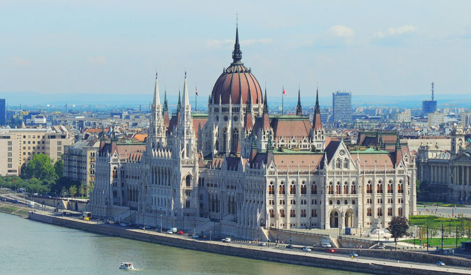 the massive Budapest parliament building on a sunny day