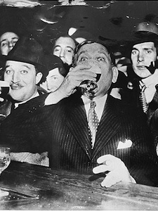 Man at the bar in the 1920s drinking, black and white