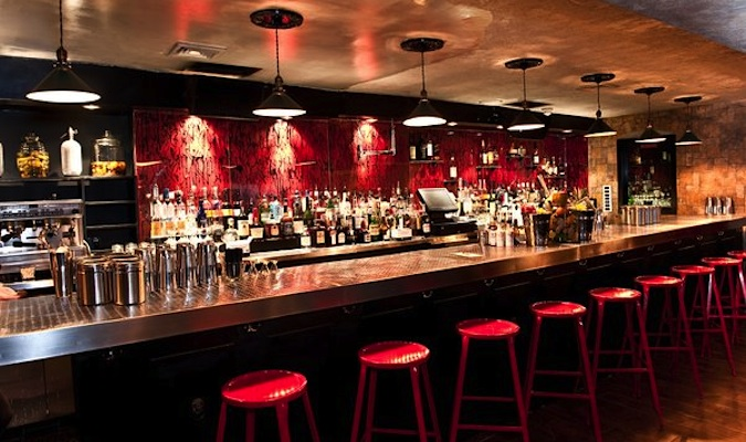 The Mulberry Project's beautiful bar with red stools is ready to be filled with thirsty New Yorkers