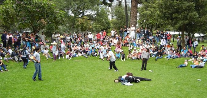 people hanging out on grass in quito