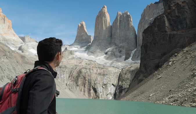 Nomadic Mattt looking at the beautiful scenery while hiking in Patagonia, Chile