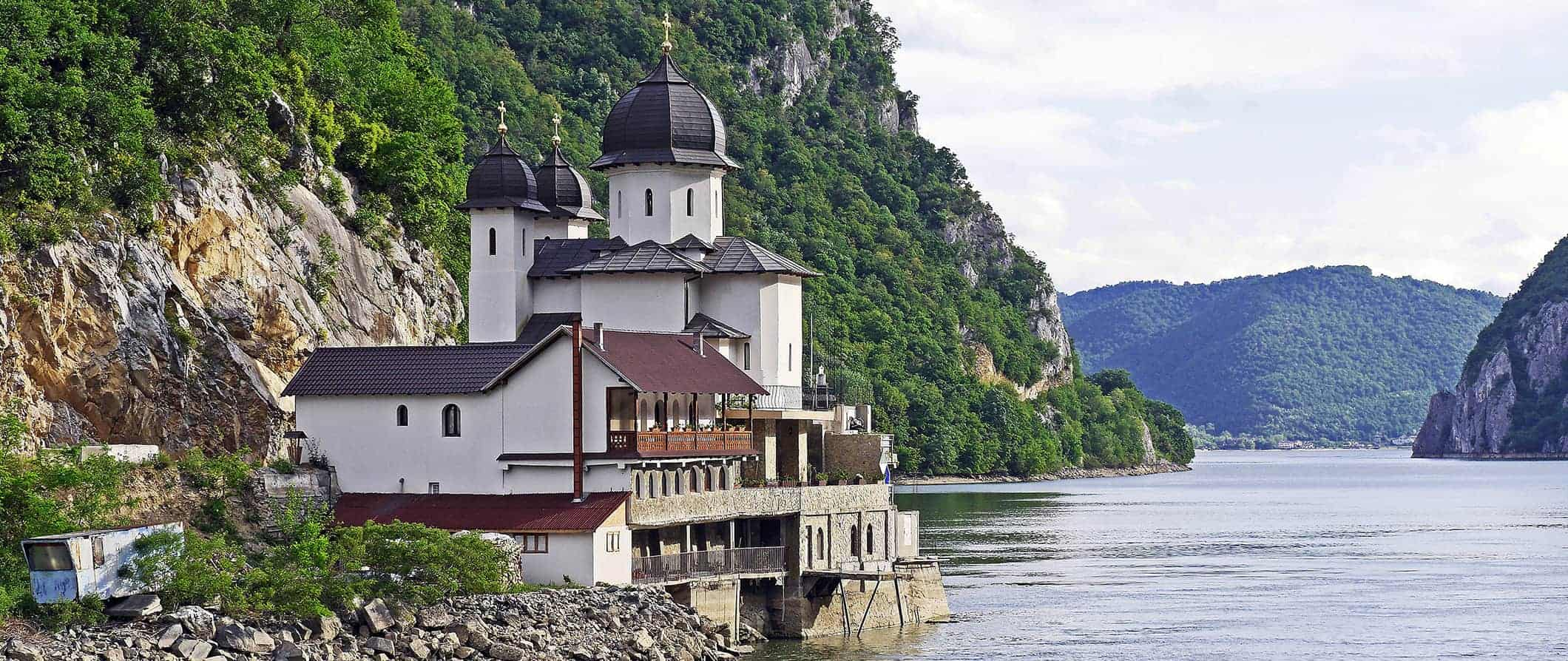 a monastery on a lake in Romania