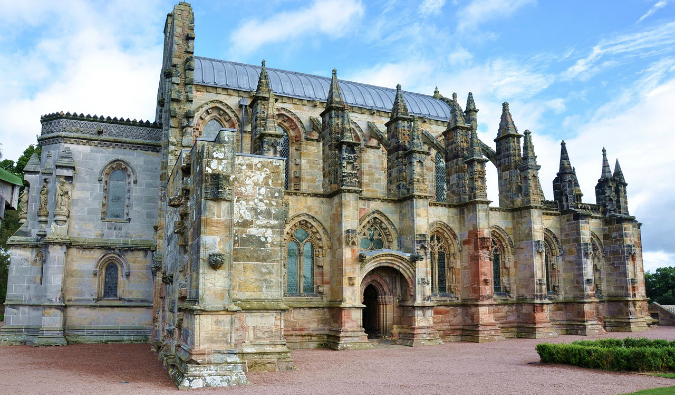 Rosslyn Chapel exterior on a sunny day in Scotland