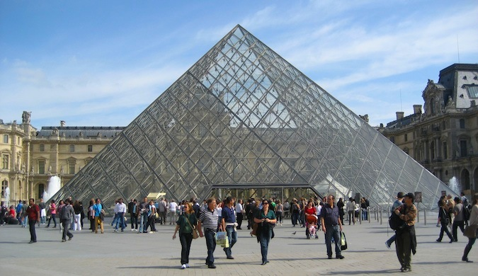 A photo of the pyramid which was designed by IM Pei at the Louvre, a popular museum in Paris