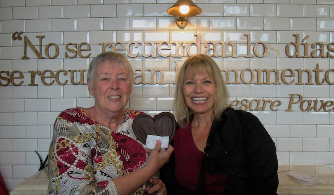 Two seniors travelers posing for a photo abroad in a restaurant