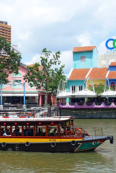 colorful boats and buildings around the Boat Quay, Singapore