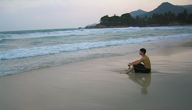 Nomadic Matt thinking on the reflective on the beaches of Thailand