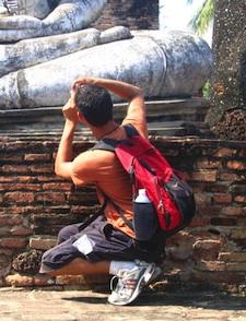 Nomadic Matt taking photos alone in Thailand