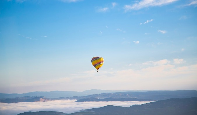 a wanderlust-inducing hot air balloon floating through the sky