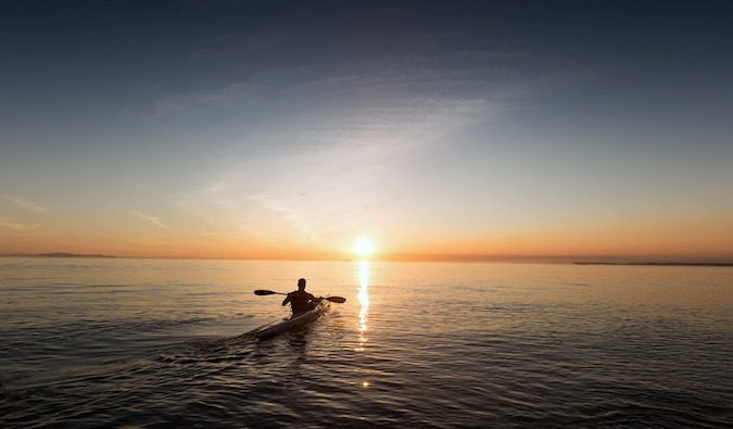 a kayaker paddling into the distance