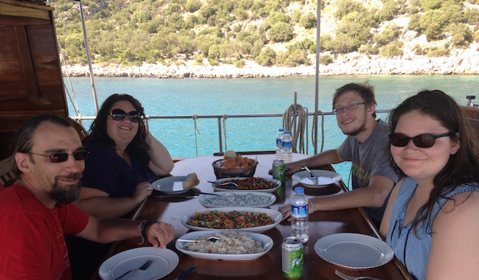 Schwarz family eating together on a Mediterranean cruise in Europe
