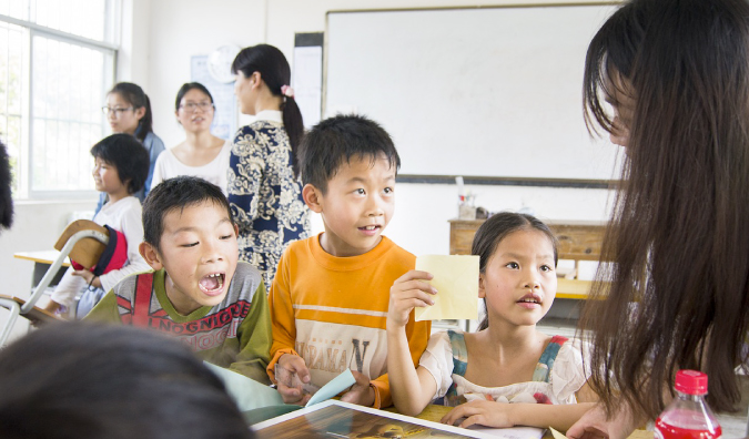 Teaching ESL in a classroom with students in Asia