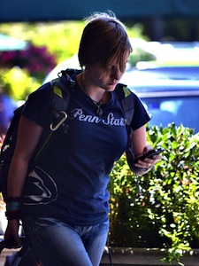traveler at airport looking at phone