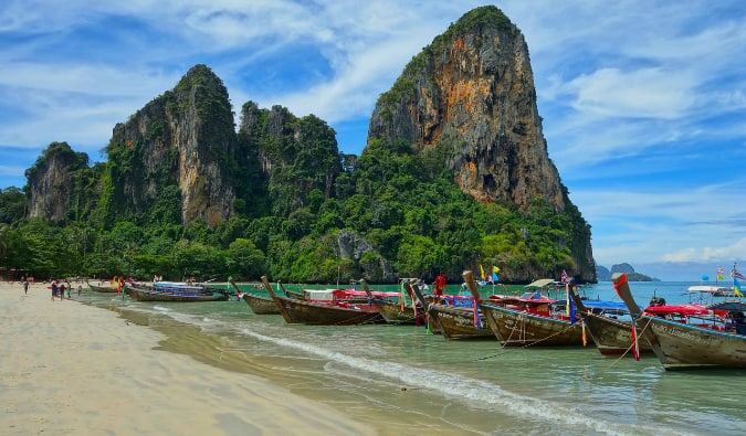 A classic shot of boats lined up along the beach in Thailand