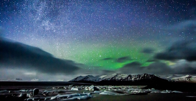 The Northern Lights coloring the sky in Iceland and making it look surreal