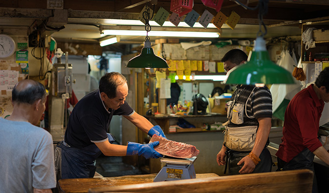 busy merchants at the Tokyo fish market