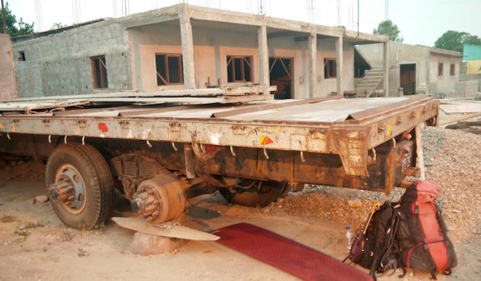 rough camping under a semi truck in Africa