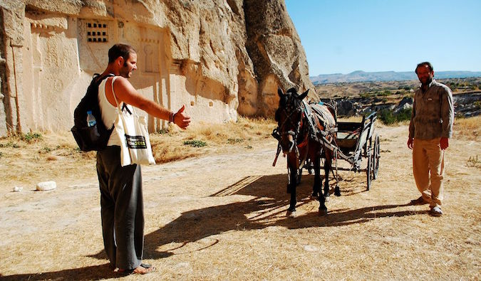 Hitchhiking a ride with a wagon and donkey in the Middle East