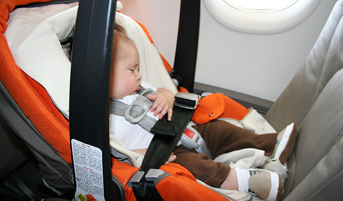 a baby sleeping on a plane