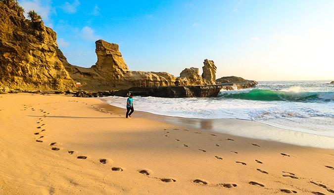 a man running along a sandy beach