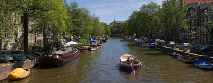 Riding along the canals of Amsterdam in North Holland.