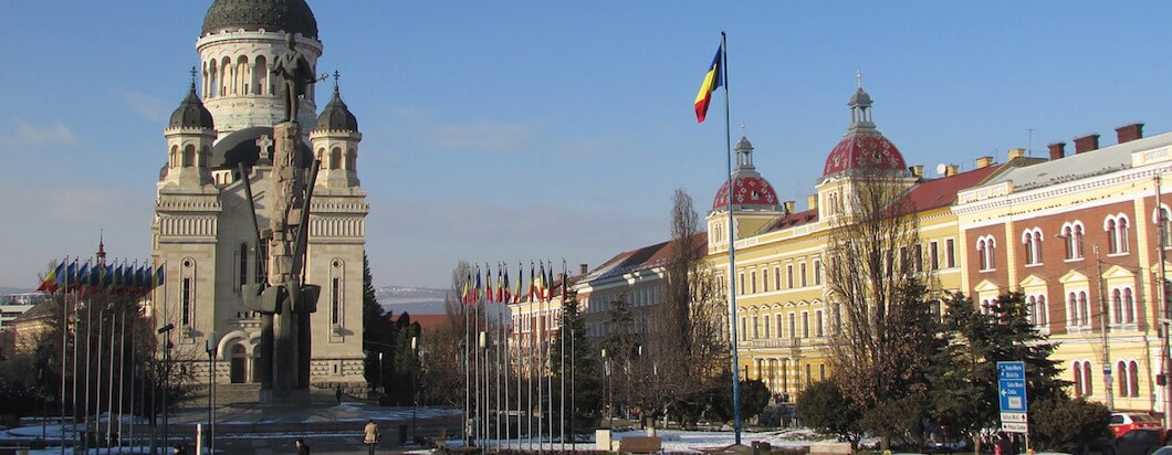 Indulge in amazing food in Cluj-Napoca's romantic main square while traveling in Romania