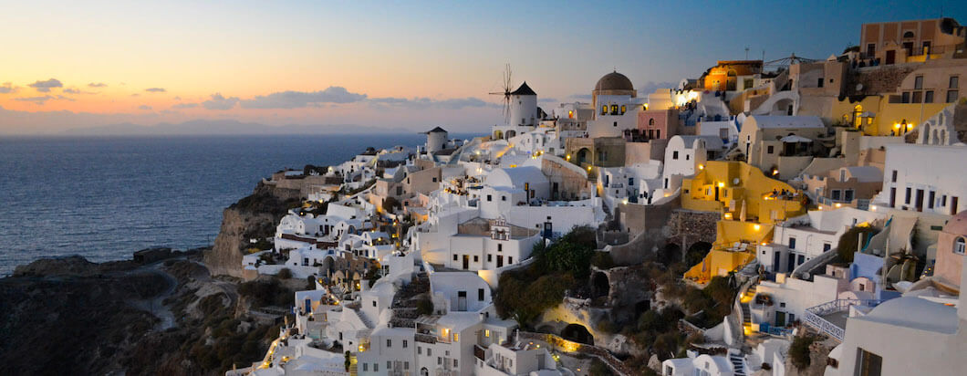 Exploring the famous blue and white homes of Santorini while traveling in Greece