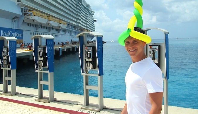 Nomadic Matt wearing a balloon hat while on a cruise