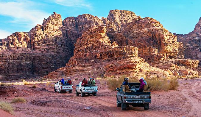 trucks driving through the desert in Jordan