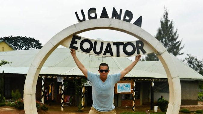 Standing at the equator in Uganda, Africa