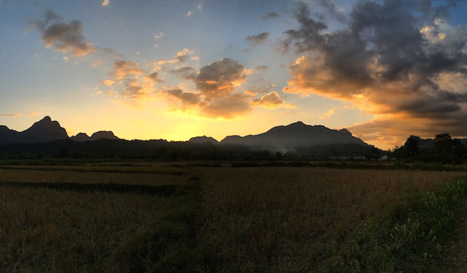 sunset on vang vieng's gorgeous landscape