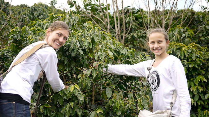 Shannon O'Donnell volunteer farming with her young niece overseas