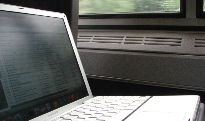 Laptop traveling on a train ride during the day overseas